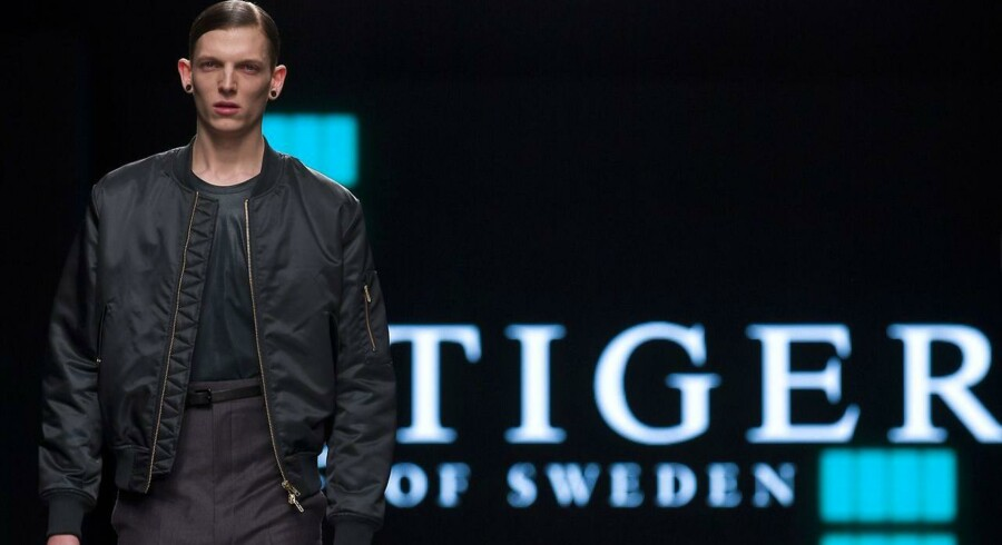 A model presents a creation by Tiger of Sweden on the final day of the Autumn/Winter 2015 London Collections: Men fashion event in London on January 12, 2015. AFP PHOTO / JUSTIN TALLIS