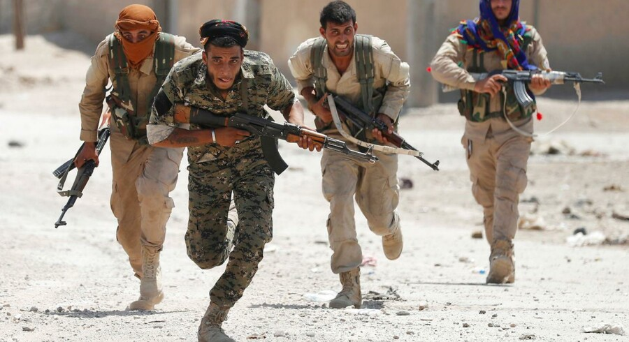 Kurdiske kæmpere fra People's Protection Units (YPG) i Raqqa, Syrien, 3. juli, 2017.