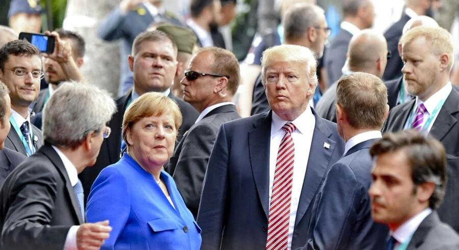 Donald Trump og Angela Merkel i centrum under G7 topmøde i Itlaien i maj 2017.