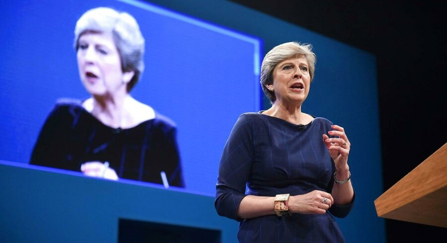 Britain's Prime Minister Theresa May delivers her speech on the final day of the Conservative Party annual conference at the Manchester Central Convention Centre in Manchester, northwest England, on October 4, 2017. / AFP PHOTO / Oli SCARFF