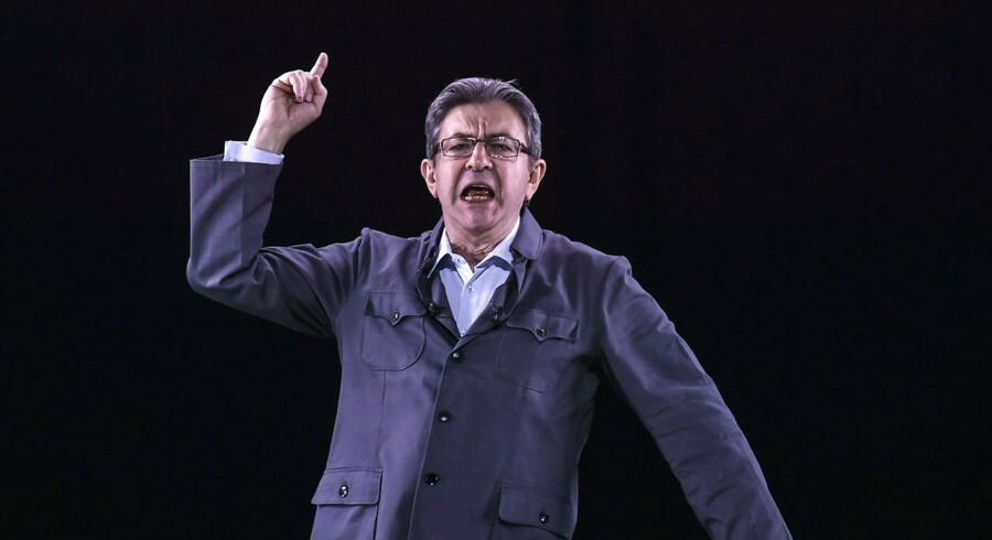 French presidential election candidate for the far-left coalition La France insoumise Jean-Luc Melenchon delivers a speech on stage during a campaign meeting, as his hologram appears at events in six other cities, on April 18, 2017 in Dijon, central France. Melenchon holds a meeting in Dijon as his holograms appear at the same time in Nantes, Montpellier, Grenoble, Clermont-Ferrand, Port de la Reunion and Nancy. / AFP PHOTO / PHILIPPE DESMAZES