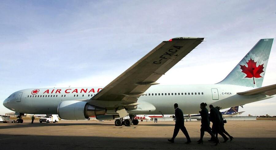 Turen til Beijing blev en dyr fornøjelse for to fulde RIM-ansatte, der fik flyet til nødlande, fik en kæmpe bøde og blevet fyret.