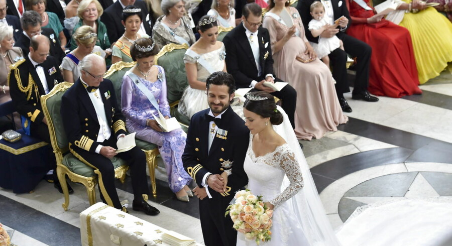 Swedish Prince Carl Philip and Sofia Hellqvist are pictured during their wedding in the Royal Chapel in Stockholm, Sweden, June 13, 2015. In the background are King Carl Gustaf, Queen Silvia, Coriwn Princess Victoria, Prince Daniel and Princess Madeleine. REUTERS/Jonas Ekstromer/TT News Agency ATTENTION EDITORS - THIS IMAGE WAS PROVIDED BY A THIRD PARTY. THIS PICTURE IS DISTRIBUTED EXACTLY AS RECEIVED BY REUTERS, AS A SERVICE TO CLIENTS. SWEDEN OUT.NO COMMERCIAL OR EDITORIAL SALES IN SWEDEN. TPX IMAGES OF THE DAY