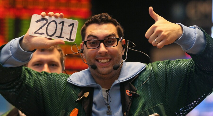 CHICAGO, IL - DECEMBER 31: A trader in the Eurodollar pit at the CME Group gives a thumbs up to 2011 after the close of the final trading session of the year December 31, 2010 in Chicago, Illinois. The U.S. stock indices posted positive returns for 2010 with the S&P, Dow and Nasdaq on pace to close the year up over 10 percent.   Scott Olson/Getty Images/AFP
