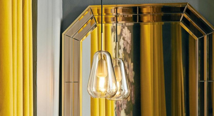 Mundblæst glas med malet inderside giver en varm belysning f.eks. i entreen. lampen er fra Anoli-serien fra det nye danske belysningsbrand Nuura. Foto: PR