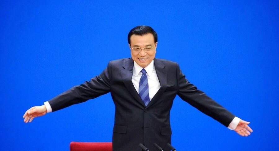 Li Keqiang er parat til at lade nogle investorer gå konkurs for at sikre tilliden til landets lånemarked.
