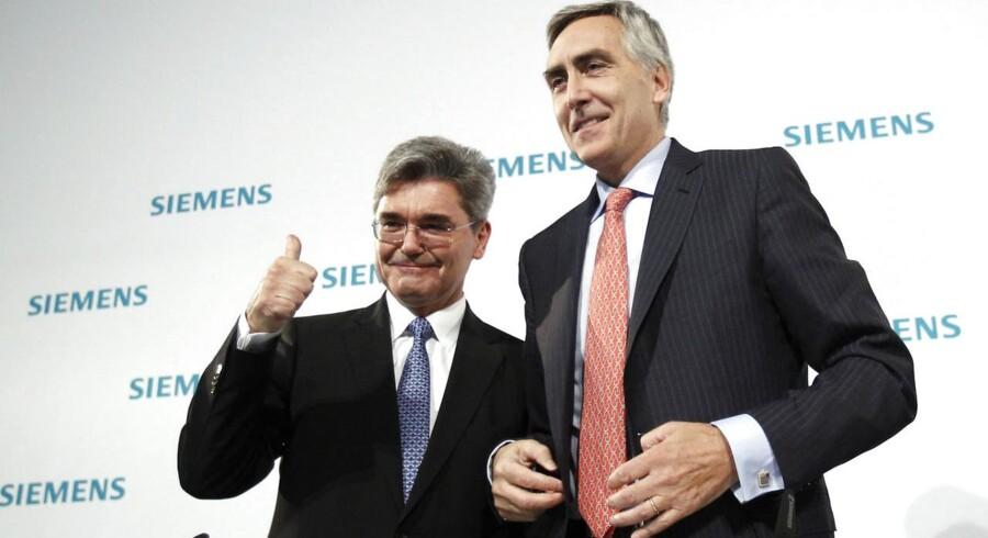 Før chefskiftet: Peter Löscher (til højre) bliver afløst som chef for Siemens af den hidtidige finansdirektør Joe Käser.