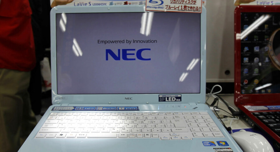 A NEC laptop PC is displayed at an electronic store in Tokyo January 21, 2011. China's Lenovo Group is in talks with Japan's NEC Corp for a joint venture in personal computers, two sources familiar with the matter said, in a deal that would help them close the gap with larger global rivals. REUTERS/Kim Kyung-Hoon (JAPAN - Tags: BUSINESS)