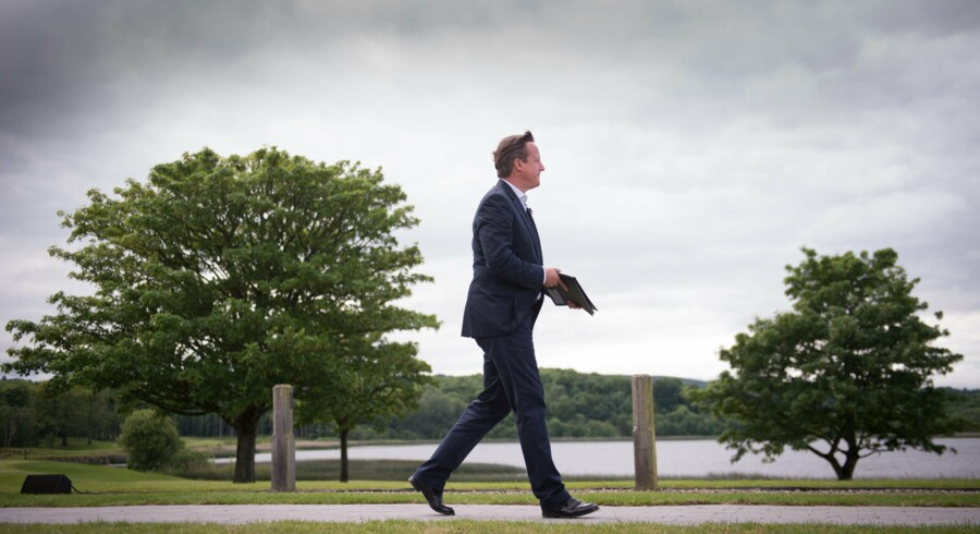 epa03750332 Prime Minister David Cameron leaves after holding a press conference at the end of this year's G8 Summit on Lough Erne near Enniskillen in Northern Ireland, 18 June 2013. Leaders from Canada, France, Germany, Italy, Japan, Russia, USA and UK met at Lough Erne in Northern Ireland for the G8 Summit 17-18 June. EPA/STEFAN ROUSSEAU / POOL UK AND IRELAND OUT