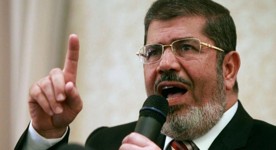 Den afsatte præsident Mohamed Morsi ved en pressekonference i Cairo tidligere på året.