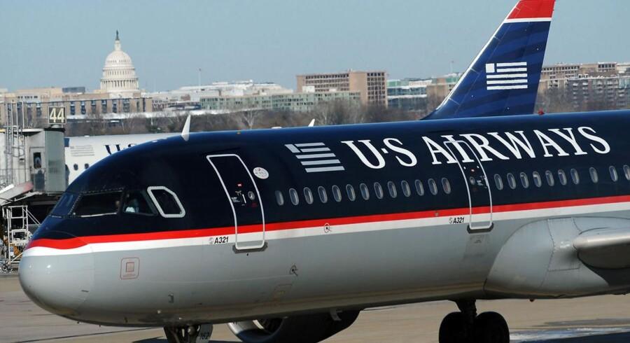 American Airlines fusionerer efter lange forhandlinger med US Airwyas og bliver verdens største luftfartsselskab