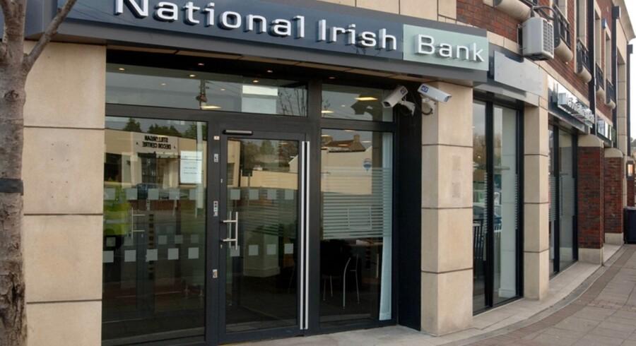 Danske Banks datterbank i Irland, National Irish Bank, har sat alle ekspansionsplaner på hold.
