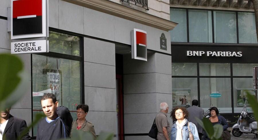 Den franske storbank Societe Generale har fået sænket sin kreditvurdering af Moody's.