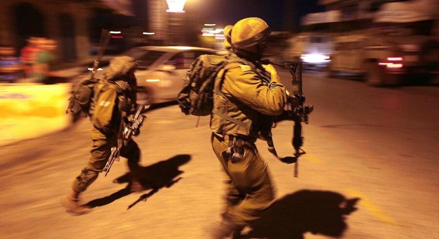 Israelske soldater på patrulje i Hebron.