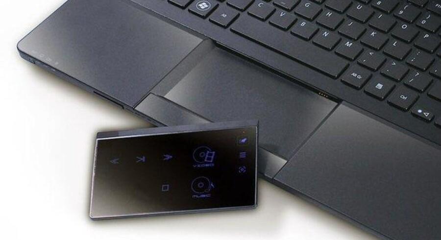 Acer har fundet ud af at integrere touch-teknologien på en bærbar: De har gjort musens pegeplade til en aftagelig touch-enhed.