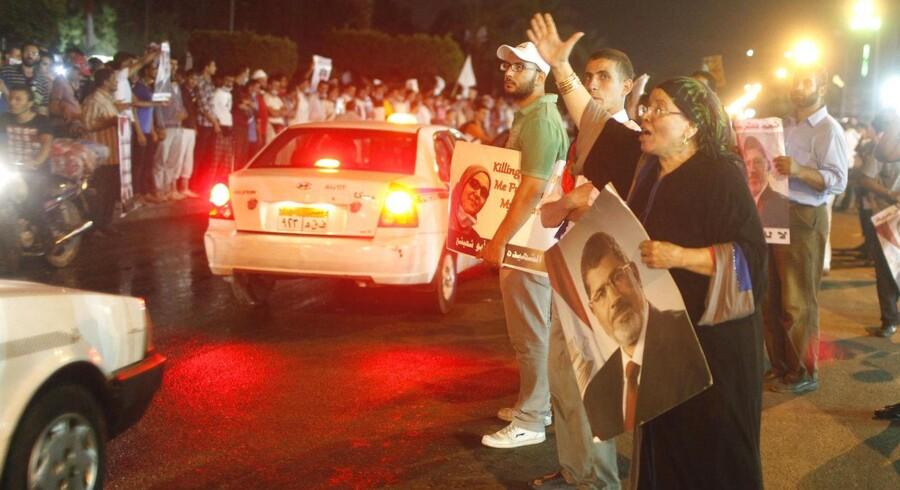 Tilhængere af den afsatte præsident Morsi sværger, at de vil kæmpe til døden for ham.