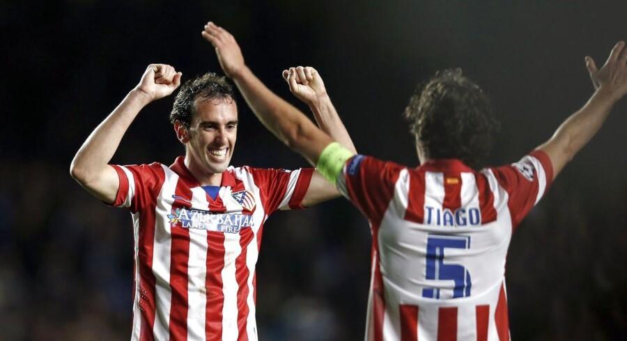 Atletico Madrids Diego Godin fejrer sammen med Tiago Mendes Champions League-finalepladsen.