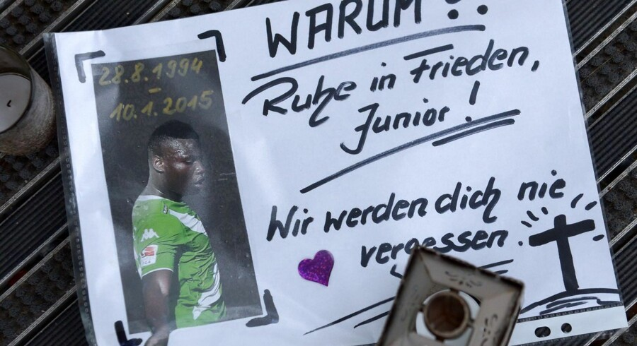 "A poster reading ""Why?? Rest in peace, Junior! We will never forget you"" lays in front of the Volkswagen Arena stadium of German first division Bundesliga football club VfL Wolfsburg in Wolfsburg, central Germany, on January 11, 2015, after a deadly car crash of the club's player Junior Malanda. Belgian under-21 international and Wolfsburg midfielder Junior Malanda died when a car he was travelling in smashed into a tree, the German club said on January 10, 2015. AFP PHOTO / DPA / PETER STEFFEN +++ GERMANY OUT"