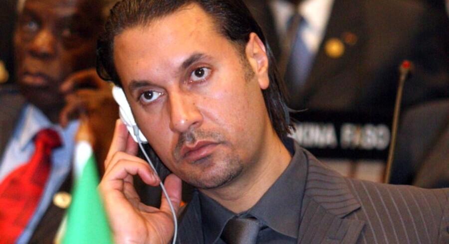 Det er angiveligt Motassim Gaddafi, der er blevet taget til fange, da han sammen med sin familie forsøgte at flygte ud af Sirte.