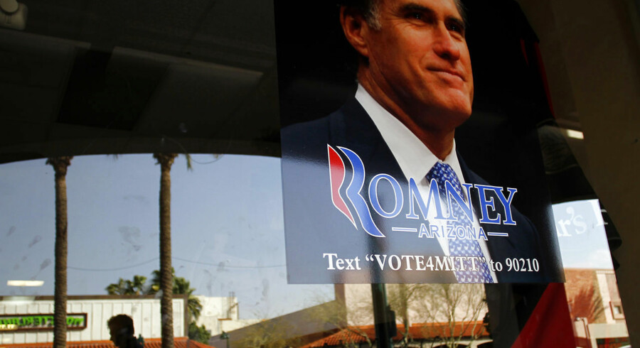 A campaign sign for Republican presidential candidate and former Massachusetts Governor Mitt Romney hangs in the window of a cafe in Mesa, Arizona February 27, 2012. Arizona registered Republicans will vote on February 28 during the presidential primary. REUTERS/Joshua Lott (UNITED STATES - Tags: POLITICS)