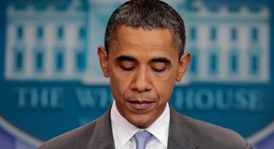 Statsgælden: En udkørt præsident Obama kunne søndag dansk tid annoncere, at der var enighed om et aftaleforslag.