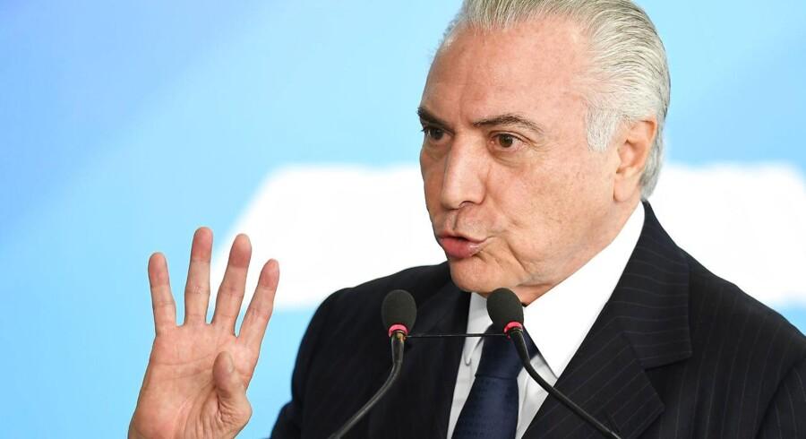 Arkivfoto. Præsident Michel Temer er tiltalt for korruption, men politikere skal afgøre, om sagen kommer for en dommer.