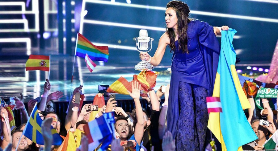 "Jamala representing Ukraine with the song ""1944"" celebrates with the trophy after winning the final of the Eurovision Song Contest 2016 Grand Final in Stockholm, on May 14, 2016. / AFP PHOTO / JONATHAN NACKSTRAND"