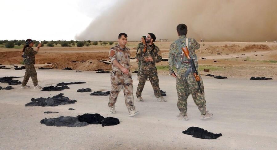 Et våbendepot er blevet ødelagt. Det er uklart, om det tilhørte Syrien, dets allierede Iran eller Hizbollah.. / AFP PHOTO / Ayham al-Mohammad