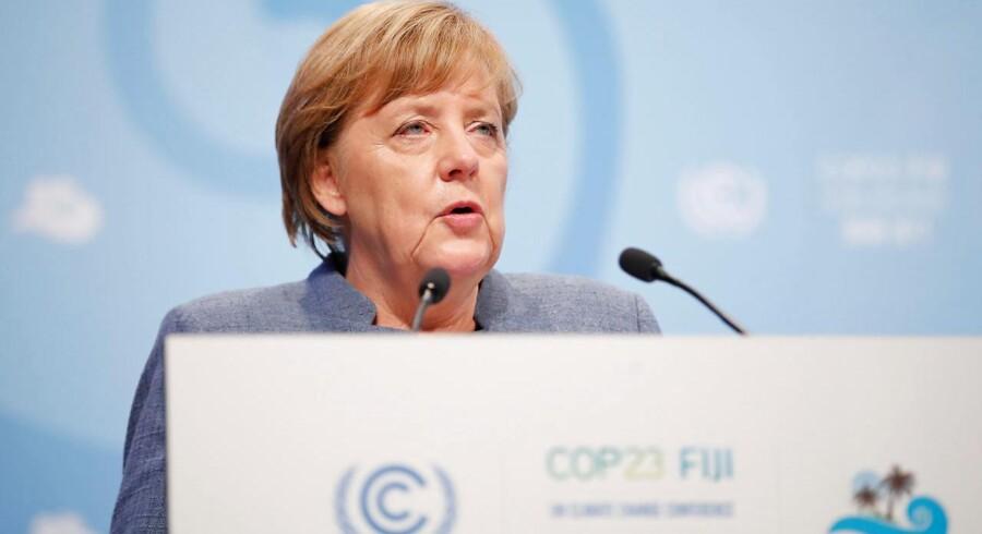 Arkivfoto. Der skal tages flere initiativer til at bremse global opvarmning, siger Merkel, mens Tyskland brænder kul.