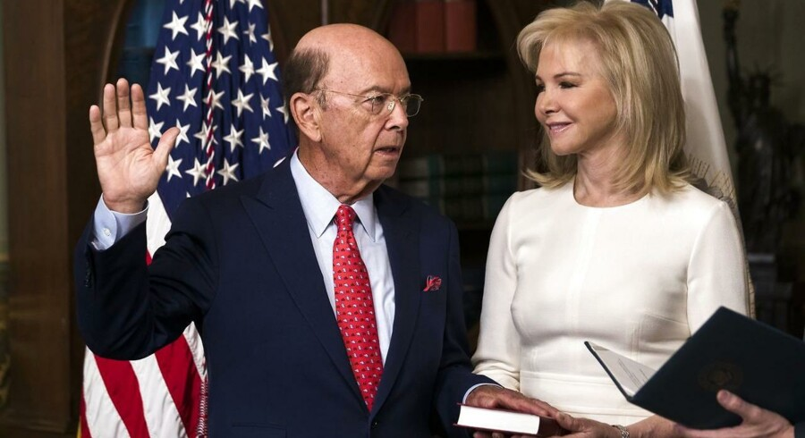 epa05820872 US Vice President Mike Pence (not pictured) swears-in Wilbur Ross (L) as the 39th Secretary of Commerce while Ross's wife, Hilary Geary (R), looks on in the Eisenhower Executive Office Building in Washington, DC, USA, 28 February 2017. The Senate confirmed Ross on 27 February by a 72-27 vote. EPA/JIM LO SCALZO
