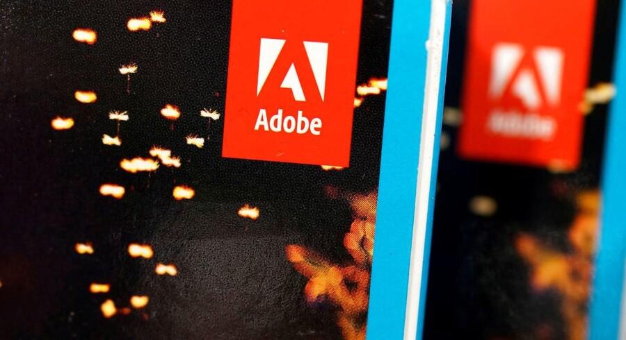 Det amerikanske softwarefirma Adobe øger overskud til 420 millioner dollar, men Wall Street sender kursen ned.