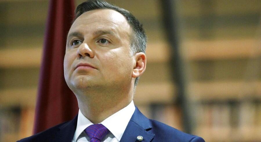 Det er en ren magtdemonstration fra den polske regerings side, at landets præsident, Andrzej Duda (billedet), har underskrevet en lov, der gør det lettere at udnævne en ny chefdommer for landets højesteret, siger Jens Mørch.