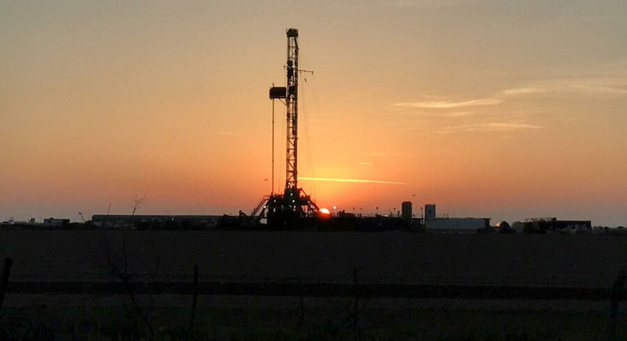 FILE PHOTO: A drilling oil rig is seen at sunrise near Midland, Texas, U.S., May 3, 2017. REUTERS/Ernest Scheyder/File Photo