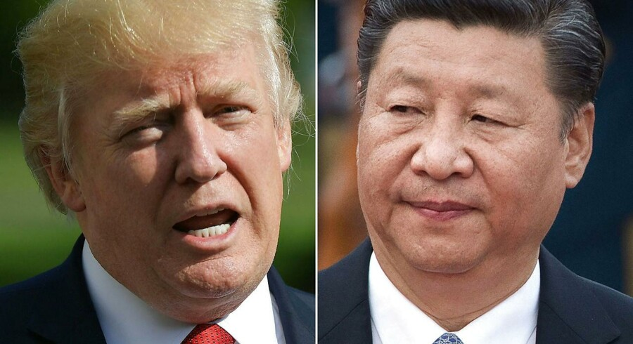 Det danske obligationsmarked ser ud til at åbne med faldende renter tirsdag morgen, efter at USA's præsident, Donald Trump, har truet med at lægge yderligere straftold på en lang række kinesiske varer. / AFP PHOTO / MANDEL NGAN AND NICOLAS ASFOURI