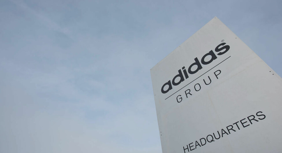 The logo of German sport brand Adidas is pictured at a stand in front of the Adidas Headquarters in Herzogenaurach on January 25, 2016. / AFP / LUKAS BARTH