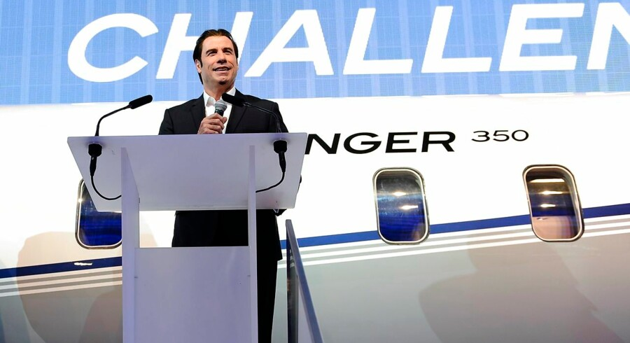 US actor John Travolta speaks to promote the new Challenger 350, a 10-seat business jet by Canadian airplane manufacturer Bombardier, during the European Business Aviation Conference and Exhibition (EBACE) on May 21, 2013, in Geneva. Manufacturers of business jets can look forward to climbing sales in the years to come thanks to emerging markets as they gather in Switzerland for an annual air show, having survived the turbulence of the global financial crisis. AFP PHOTO / ALAIN GROSCLAUDE
