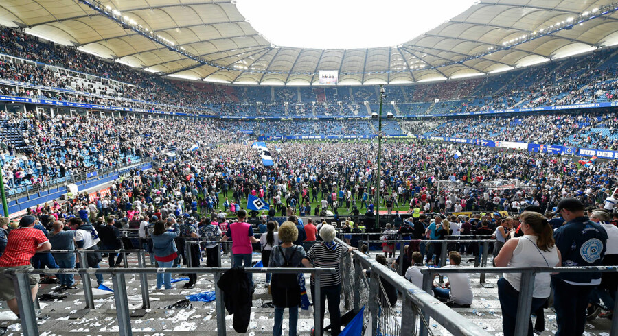 Football Soccer - Hamburg SV v VfL Wolfsburg - Bundesliga - Volkspark Stadium, Hamburg, Germany - 20/5/17 Hamburg fans celebrate on the pitch after the game Reuters / Fabian Bimmer Livepic DFL RULES TO LIMIT THE ONLINE USAGE DURING MATCH TIME TO 15 PICTURES PER GAME. IMAGE SEQUENCES TO SIMULATE VIDEO IS NOT ALLOWED AT ANY TIME. FOR FURTHER QUERIES PLEASE CONTACT DFL DIRECTLY AT + 49 69 650050.