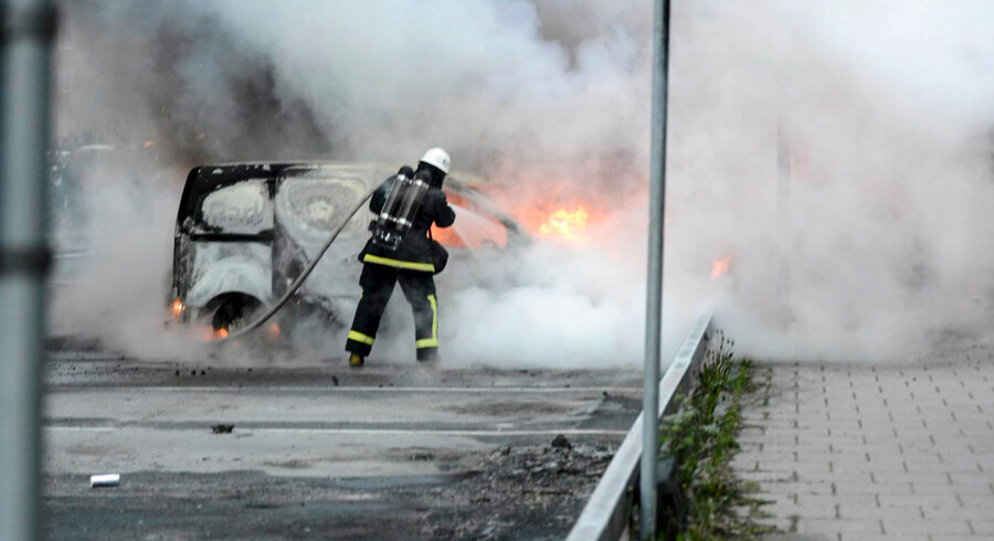 Firemen extinguish burning cars in the Stockholm suburb of Rinkeby after youths rioted in several different suburbs around Stockholm, Sweden for a fourth consecutive night on May 23, 2013. In the suburb of Husby, where the riots began on Sunday in response to the fatal police shooting of a 69-year-old machete-wielding man, 80 percent of residents are immigrants and the unrest has highlighted Sweden's failure to integrate swathes of its immigrant population, but in this small, consensus-driven country, there was little agreement on how to solve the problem. AFP PHOTO /SCANPIX SWEDEN/ FREDRIK SANDBERG SWEDEN OUT