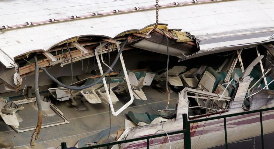 Flere af togene blev smadret til ukendelighed ved togulykken i Santiago de Compostela i det nordvestlige Spanien den 25. juli 2013.