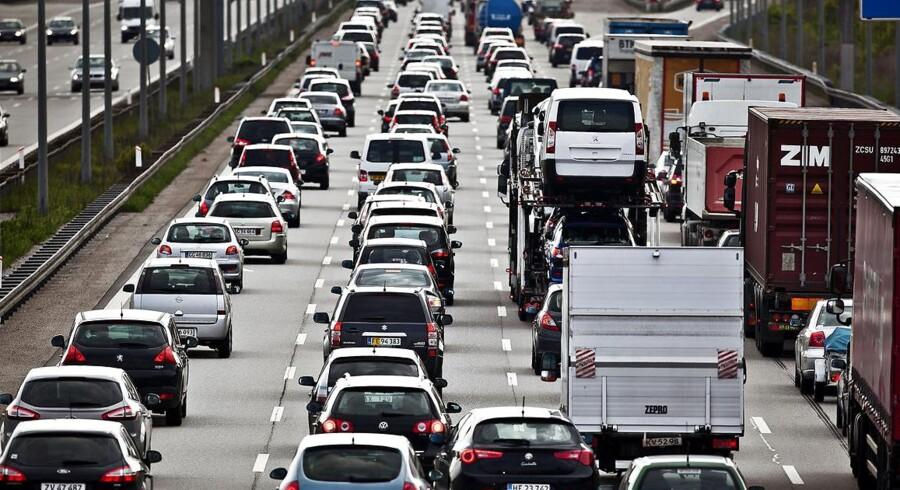 Tid - for meget tid - på landevejen koster milliarder, mener erhvervslivet.