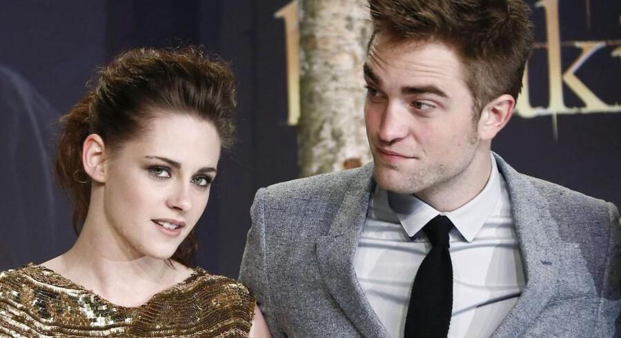 Kristen Stewart og Robert Pattinson - måske bedre kendt som Bella og Edward - ved den tyske premiere på »Breaking Dawn - Part 2«, som har slået de tidligere rekorder i Twilight-serien.