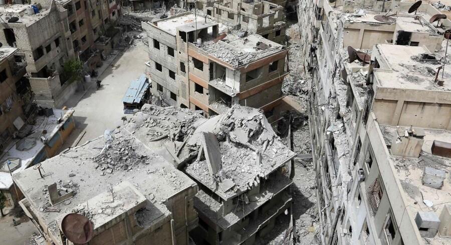 Arkivfoto fra den syriske by Douma. AFP PHOTO / STRINGER / Ritzau Scanpix