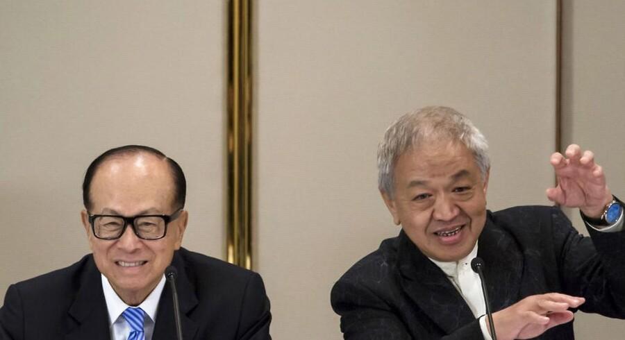 Hongkong-industrimagnaten Li Ka-shing (til venstre) og koncernchefen for hans konglomerat Hutchison Whampoa, Canning Fok (til højre), er igen på opkøb i europæisk teleland. Selskabet ejer 60 procent af det danske mobilselskab »3«. Foto: Tyrone Siu, Reuters/Scanpix
