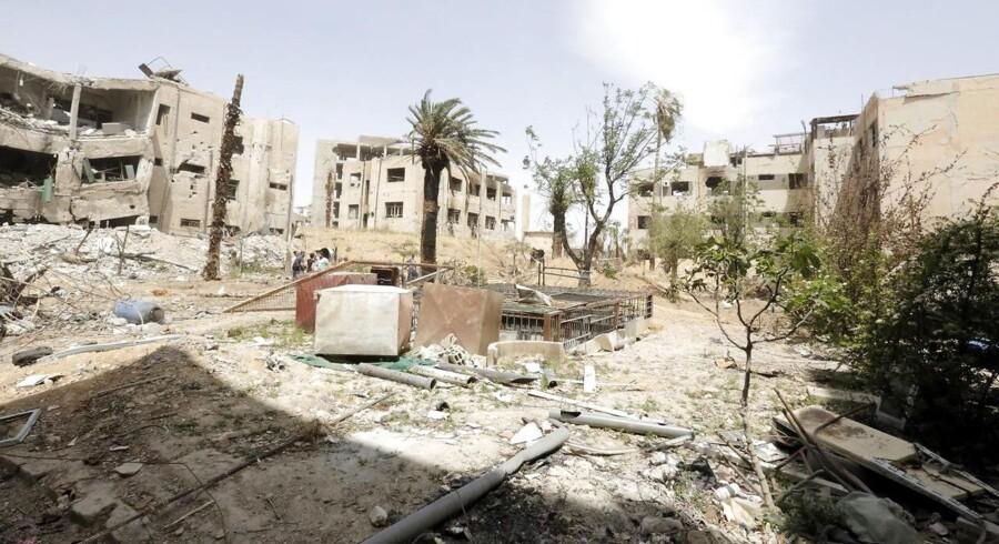 Billede fra byen Douma øst for Syriens hovedstad.