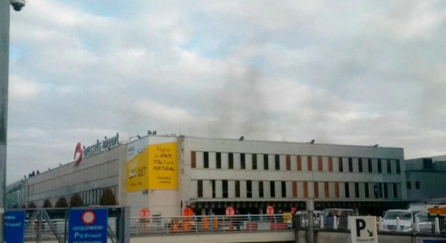 Black smoke is seen rising from the Brussels airport following explosions, in this still image made available March 22, 2016. REUTERS/Peter van Rossum via Reuters TV ATTENTION EDITORS - THIS PICTURE WAS PROVIDED BY A THIRD PARTY. REUTERS IS UNABLE TO INDEPENDENTLY VERIFY THE AUTHENTICITY, CONTENT, LOCATION OR DATE OF THIS IMAGE. EDITORIAL USE ONLY. NOT FOR SALE FOR MARKETING OR ADVERTISING CAMPAIGNS.NO RESALES.NO ARCHIVE. THIS PICTURE IS DISTRIBUTED EXACTLY AS RECEIVED BY REUTERS, AS A SERVICE TO CLIENTS. BELGIUM OUT.NO COMMERCIAL OR EDITORIAL SALES IN BELGIUM TPX IMAGES OF THE DAY