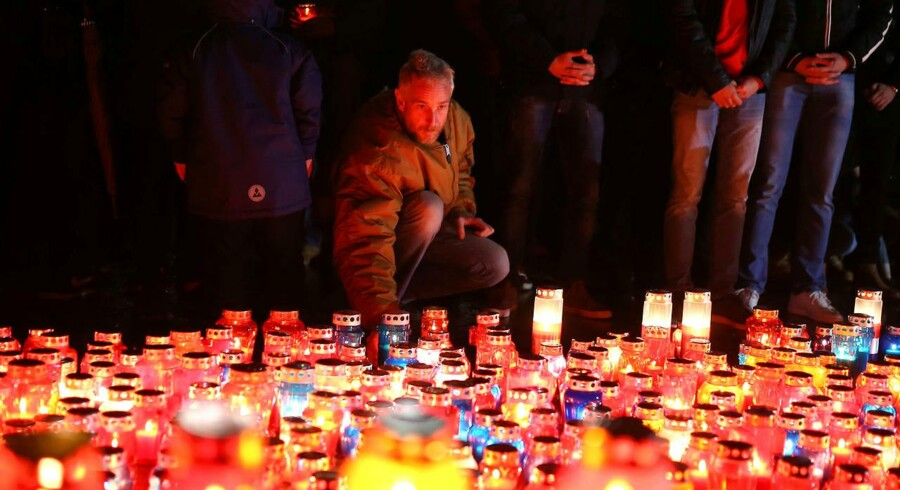 Bosnian Croats pray and light candles for the convicted general Slobodan Praljak, who killed himself seconds after the verdict in the U.N. war crimes tribunal in The Hague, in Mostar, Bosnia and Herzegovina November 29, 2017. REUTERS/Dado Ruvic