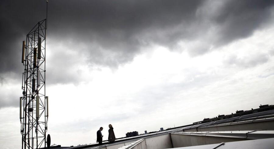 Mørke skyer hænger over den danske telebranche, som trods udskiftning og udbygning af mobilnettene bruger stadig færre penge på nyt udstyr, hvilket giver bekymring. Arkivfoto: Jeppe Bøje Nielsen, Scanpix
