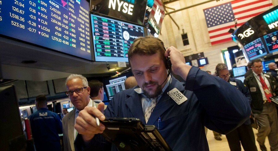 Traders work on the floor of the New York Stock Exchange at the closing bell of the Dow Jones Industrial Average on June 8, 2017 in New York. Wall Street stocks ended higher Thursday as investors took in stride dramatic testimony from ousted FBI chief James Comey on his firing by President Donald Trump and links to the Russia investigation. The advance was good enough to lift the Nasdaq to a fresh record, while the Dow and S&P 500 eked out modest gains. / AFP PHOTO / Bryan R. Smith