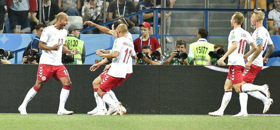Denmark's Mathias Jorgensen, left, celebrates with teammates after scoring his side's first goal during the round of 16 match between Croatia and Denmark at the 2018 soccer World Cup in the Nizhny Novgorod Stadium, in Nizhny Novgorod , Russia, Sunday, July 1, 2018. (AP Photo/Martin Meissner)