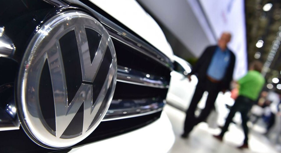 (FILES) This file photo taken on June 22, 2016 shows a Volkswagen logo on a VW Tiguan on display during German carmaker Volkswagen shareholders' annual general meeting in Hanover. German automaker Volkswagen AG said March 30, 2017 it reached a settlement with 10 US states on environmental and consumer claims stemming from its emissions cheating scandal. The company has agreed to pay $157.5 million to the states, including New York, Massachusetts and Pennsylvania, resolving suits by the states against VW for violating emissions standards. / AFP PHOTO / JOHN MACDOUGALL